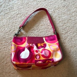 Small Coach leather and satin colored handbag.